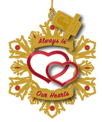 gold and red ornament with hearts