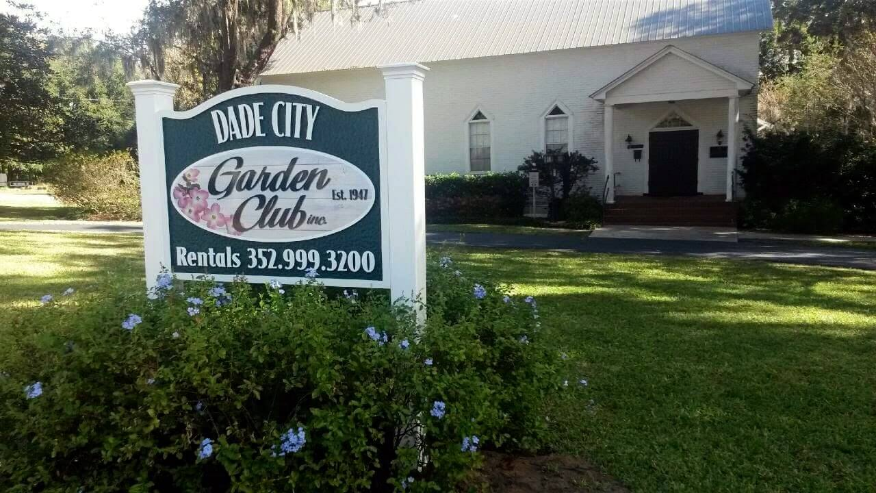 picture of Dade City Garden Club with green grass and bushes