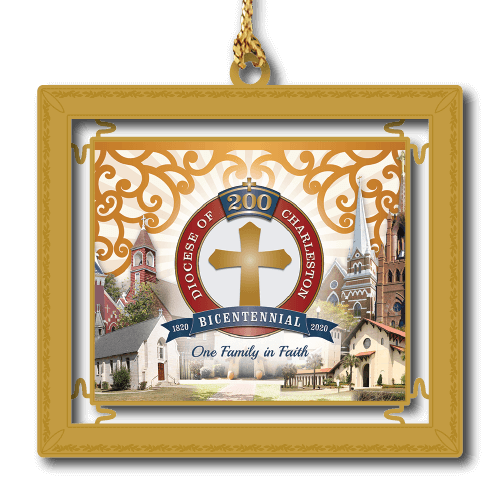 Commemorative gold framed ornament with red circle and cross gold cross in the middle