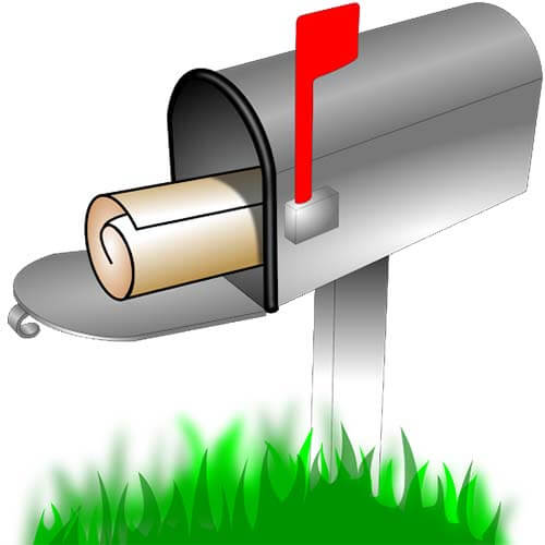 Mailbox in the grass with a letter