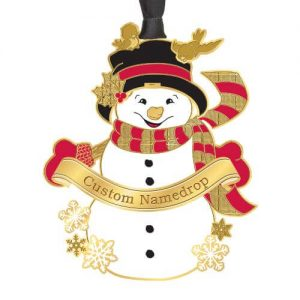 snowman holding banner with red and gold scarf