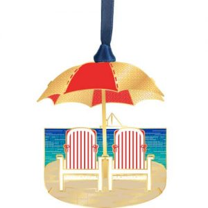 chairs on the beach with umbrella ornament