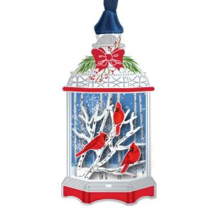 Red Cardinal birds in lantern ornament